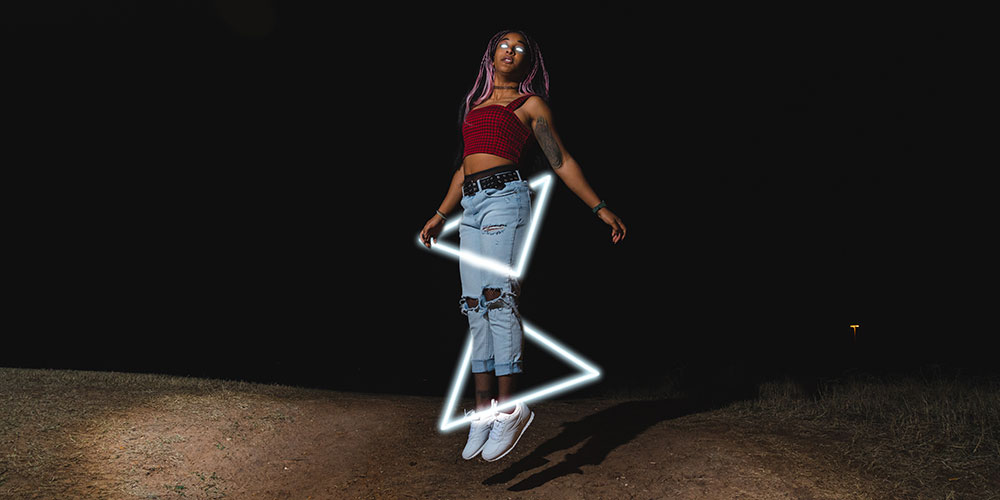 Meagan Bolds self-portrait at night with lighted triangles