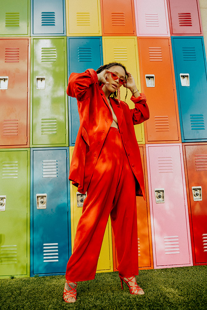Cynthia Brown portrait of a model in front of a wall of lockers