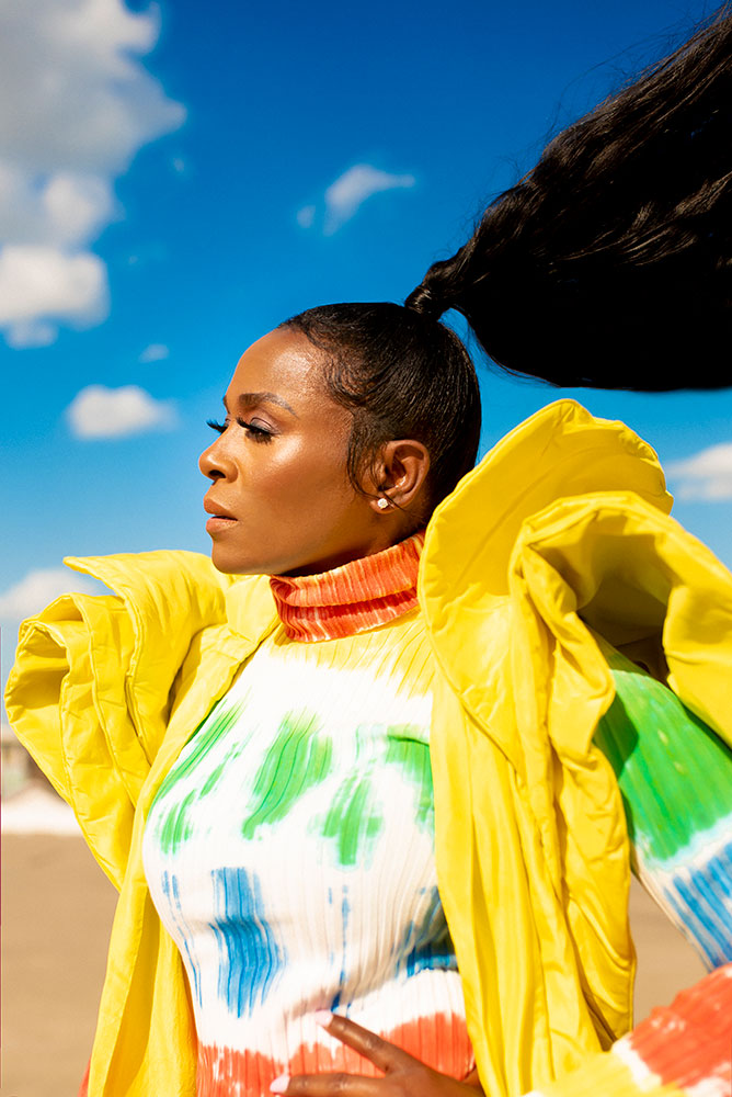 Cynthia Brown portrait of a model in bright colors with a huge ponytail